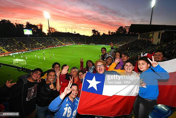 Chile fans pose for photos during the FIFA U17 Men's World Cup 2015 group A match between USA and Chile at Estadio Sausalito on October 23 2015 in...