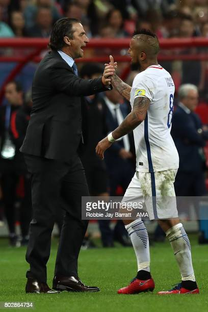 Chile Head Coach / Manager Juan Antonio Pizzi celebrates with Arturo Vidal of Chile after winning a penalty shootout during the FIFA Confederations...