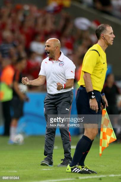 Chile manager Jorge Sampaoli celebrates victory at the final whistle