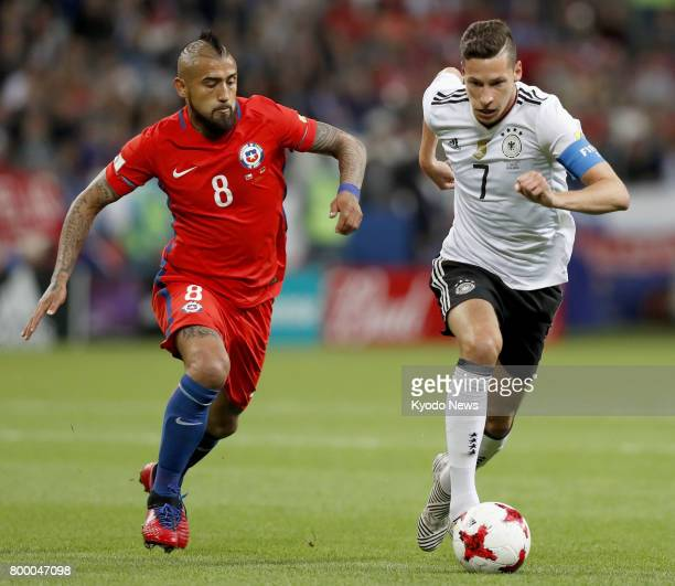 Chile midfielder Arturo Vidal chases Germany's Julian Draxler during the first half of a Group B match of the FIFA Confederations Cup in Kazan Russia...