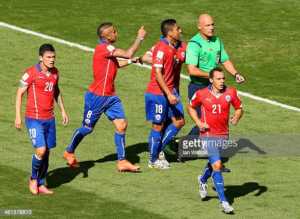 Chile players appeal for a card to referee Howard Webb after a hand ball by Hulk of Brazil during the 2014 FIFA World Cup Brazil round of 16 match...