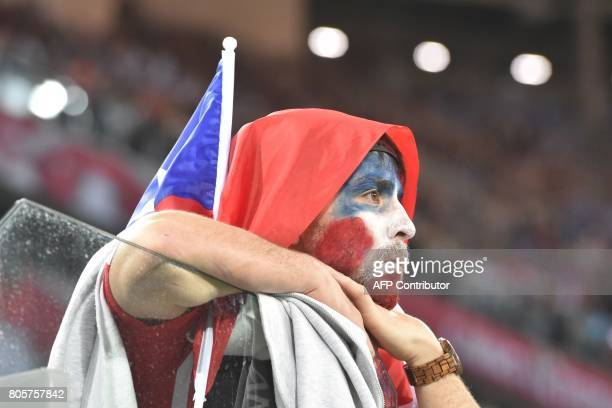 A Chile supporter reacts at the end of the 2017 Confederations Cup final football match between Chile and Germany at the Saint Petersburg Stadium in...