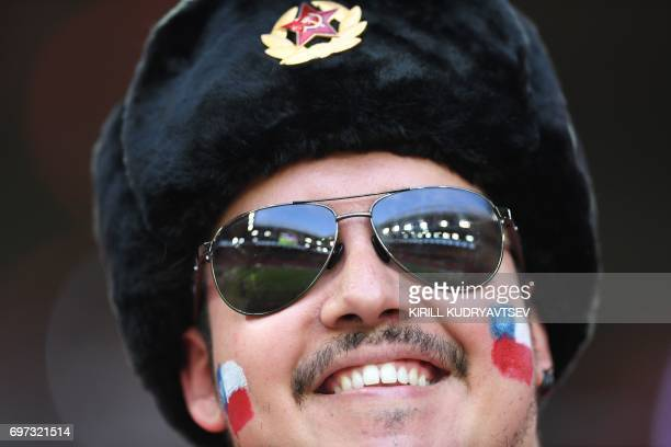 Chile supporter smiles ahead of the 2017 Confederations Cup group B football match between Cameroon and Chile at the Spartak Stadium in Moscow on...