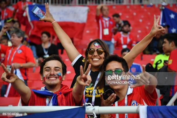 TOPSHOT Chile supporters cheer ahead of the 2017 Confederations Cup group B football match between Cameroon and Chile at the Spartak Stadium in...