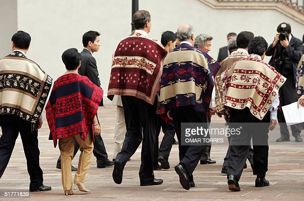 The APEC leaders leave the Oranges Patio after the official photograph in La Moneda palace in Santiago 21 November 2004 on the last day of the...