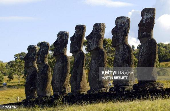 TO GO WITH AFP STORY FILES Picture taken 12 February 2005 shows a tourist walking behind a platform with seven huge statues the only ones facing the...