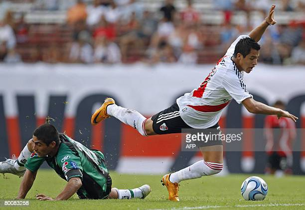 Chilean Alexis Sanchez of River Plate falls after clashing with Ariel Aguero of San Martin of San Juan during their Argentinas first division...