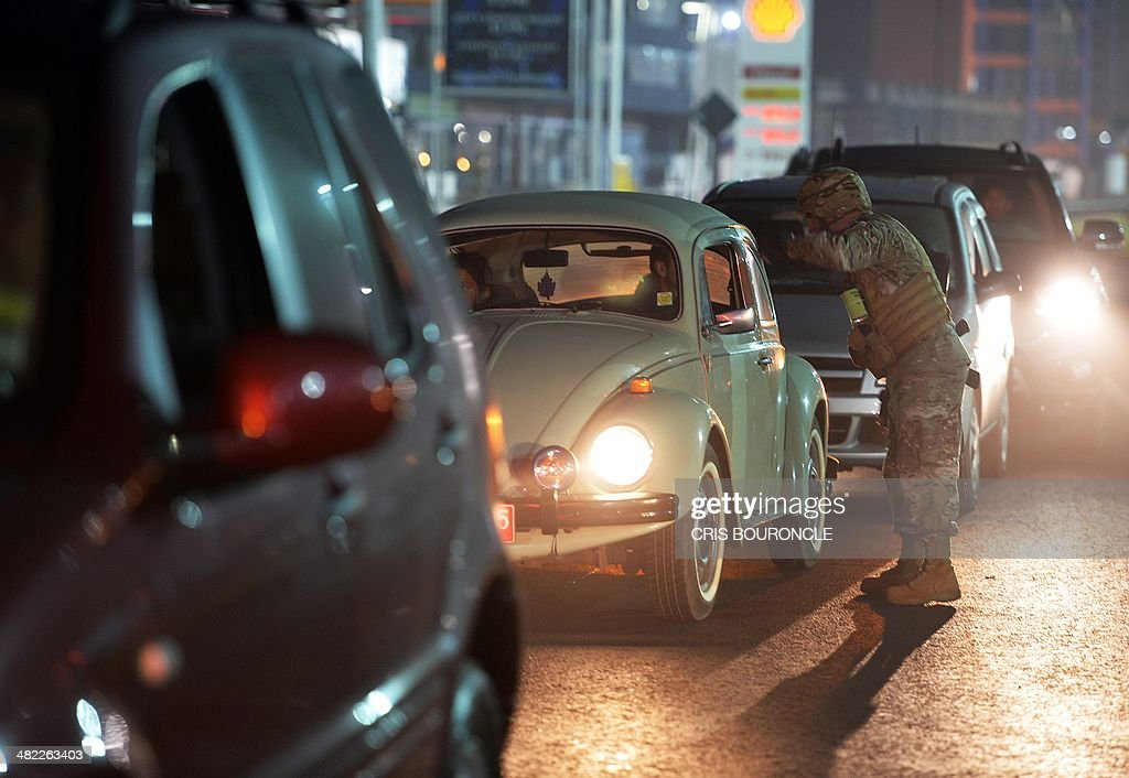A Chilean Army soldier speaks with a car driver as he guards a gas station in Iquique950 kilometres north of Santiago where fuel is being rationed on...