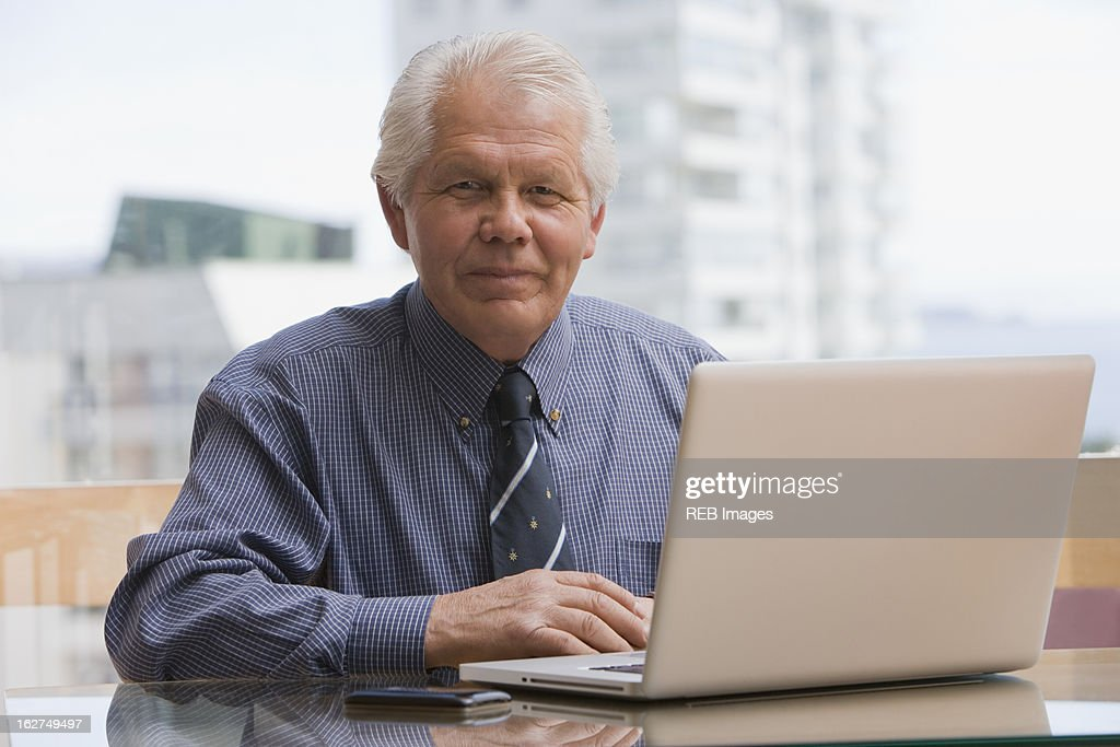 Chilean businessman sitting at desk with laptop