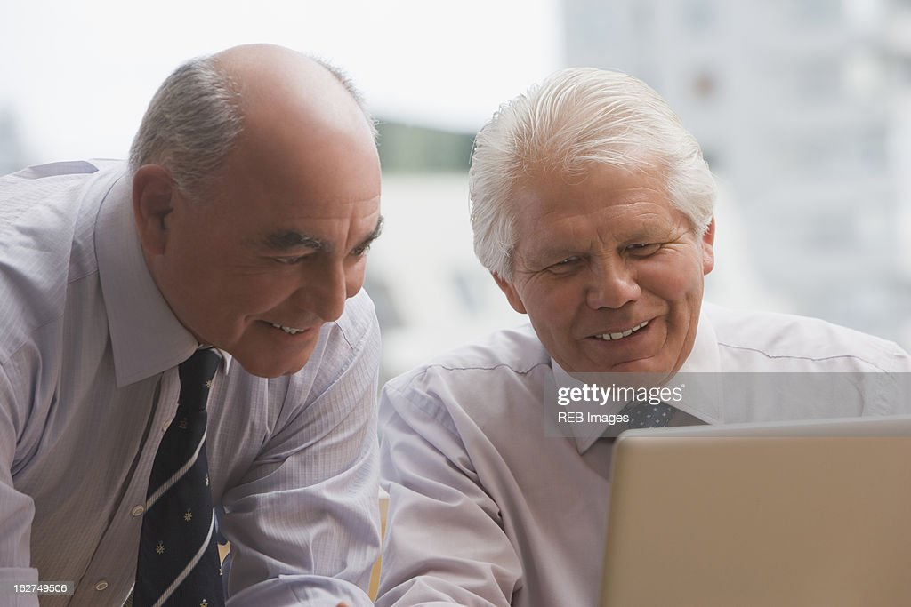 Chilean businessmen looking at laptop