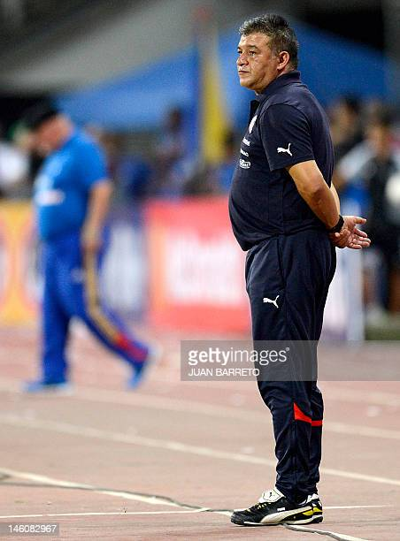 Chilean coach Claudio Borghi looks on during their Brazil 2014 FIFA World Cup South American qualifier match against Venezuela held at the Jose...