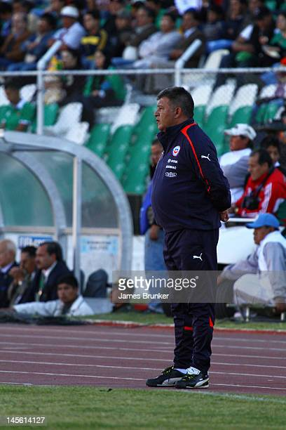 Chilean coach Claudio Borghi watches from the touchline during a match between Chile and Bolivia at Hernando Siles Stadium as part of the fifth round...