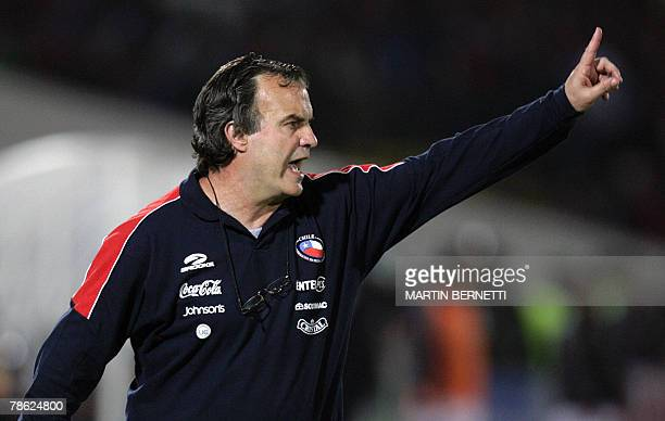 STORY Chilean coach Marcelo Bielsa gives instructions to his players during their FIFA World Cup South Africa2010 qualifying round match at the...
