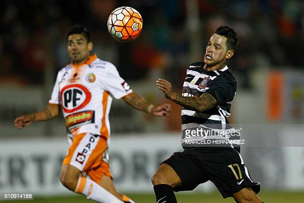 Chilean Cobresal Alejandro Escalona vies for the ball with Giovanni Augusto of Brazilian Corinthians during their Copa Libertadores football match in...