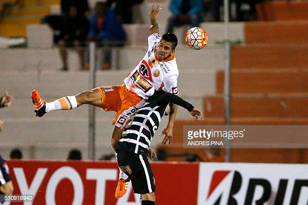 Chilean Cobresal Jonathan Benitez vies for the ball with a Brazilian Corinthians defender during their Copa Libertadores football match in El...