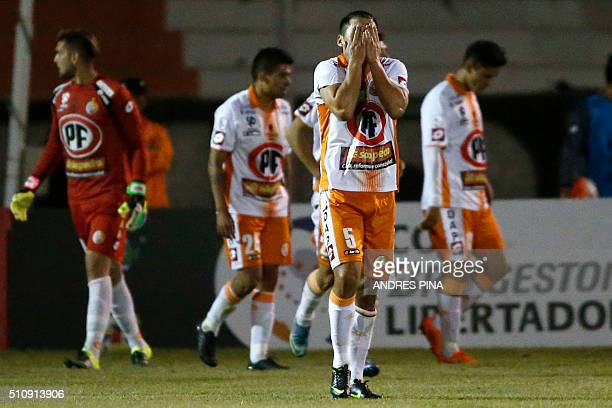 Chilean Cobresal's players react in dejection after scoring an own goal during their Copa Libertadores football match against Brazilian Corinthians...