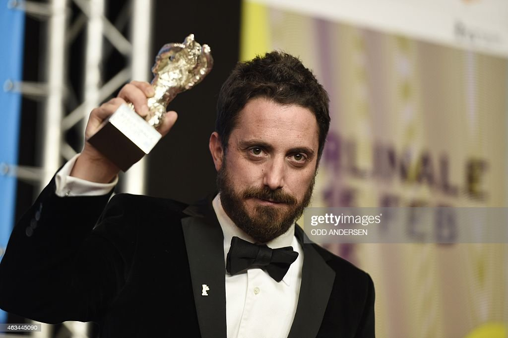Chilean director Pablo Larrain poses with the Silver Bear Grand Jury Prize for his film El Club at the award winners press conference after the...