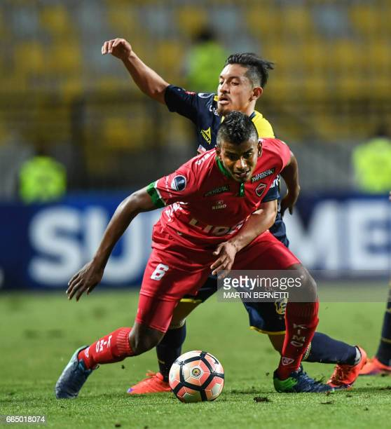 Chilean Everton's Camilo Rodriguez vies for the ball with Colombian Patriotas FC's Uvaldo Luna during their Copa Sudamericana first leg football...