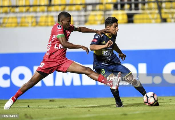 Chilean Everton's Dilan Zuniga vies for the ball with Colombian Patriotas FC's Edis Ibarguen during their Copa Sudamericana first leg football match...