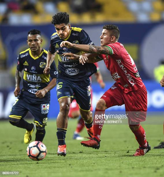Chilean Everton's Nicolas Orellana vies for the ball with Colombian Patriotas FC's Nicolás Carreño during their Copa Sudamericana first leg football...