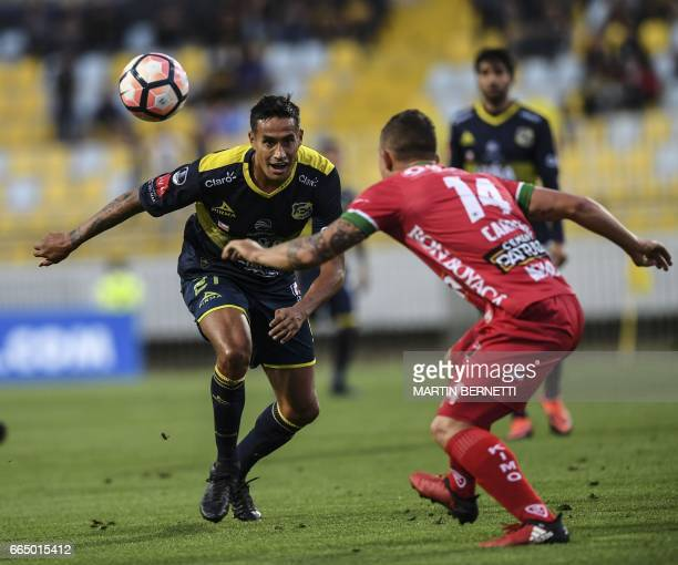 Chilean Everton's Raul Becerra vies for the ball with Colombian Patriotas FC's Nicolas Carreno during their Copa Sudamericana first leg football...