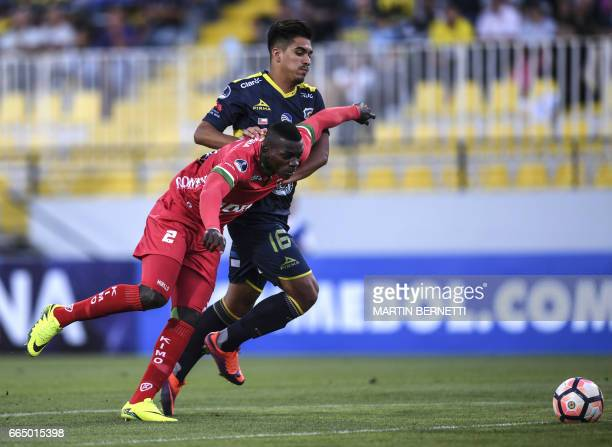 Chilean Everton's Sebastian Gonzalez vies for the ball with Colombian Patriotas FC's Jesus Murillo during their Copa Sudamericana first leg football...