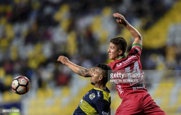 Chilean Everton's Wilson Morelo vies for the ball with Colombian Patriotas FC's Nicolás Carreño during their Copa Sudamericana first leg football...
