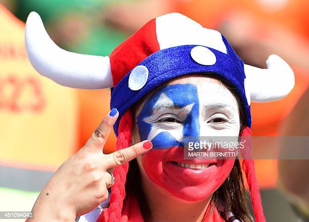 A Chilean fan reacts prior to a Group B football match between Netherlands and Chile at the Corinthians Arena in Sao Paulo during the 2014 FIFA World...