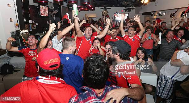 TORONTO ON JUNE 28 Chilean fans cheer as Chile ties the game at ones in the first half as their team plays Brazil in the round of 16 at the World Cup...