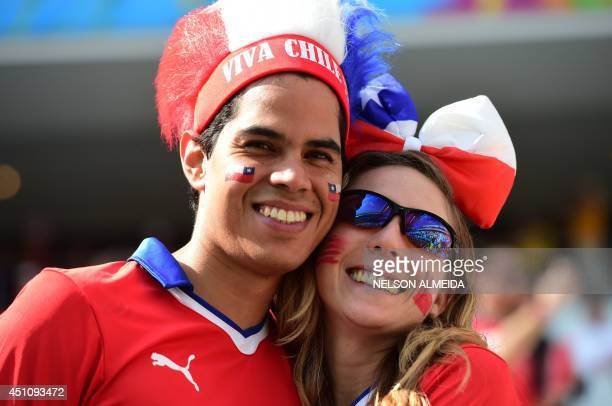 Chilean fans pose prior to a Group B football match between Netherlands and Chile at the Corinthians Arena in Sao Paulo during the 2014 FIFA World...