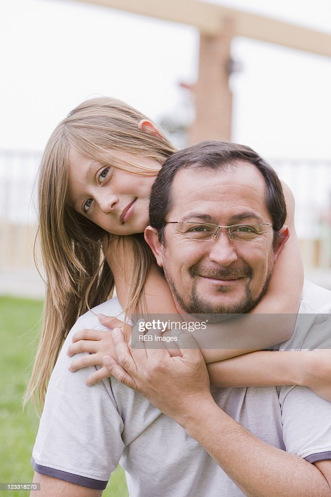Chilean father and daughter hugging outdoors