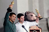 Chilean filmmakers of 'Bear Story' Gabriel Osorio and Patricio Escala hold their Academy Award for best animated short film as they pose for the...