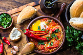 Chilean food. 'Picante Caliente' or 'spicy hot' with onion, tomatos, chilli aand eggs in tipicacal chilleann cllay pan
