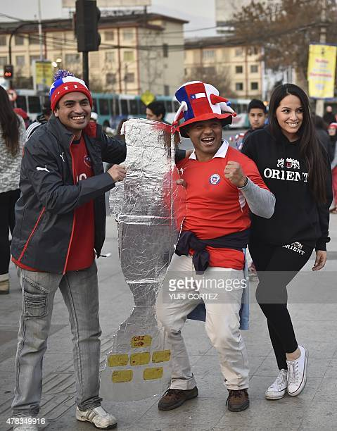 Chilean football fans arrive at the National stadium for the Copa America quarterfinal football match Chile vs Uruguay on June 24 2015 in Santiago...