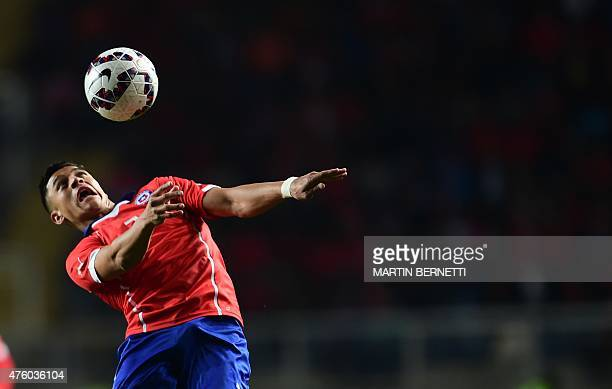 Chilean footballer Alexis Sanchez controls the ball during a friendly football match against El Salvador at El Teniente Stadium in Rancagua some 80...