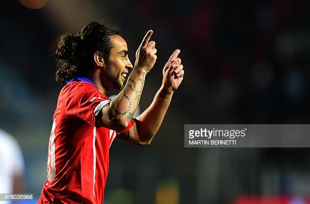 Chilean footballer Jorge Valdivia celebrates his goal over El Salvador during a friendly football match at El Teniente Stadium in Rancagua some 80 km...