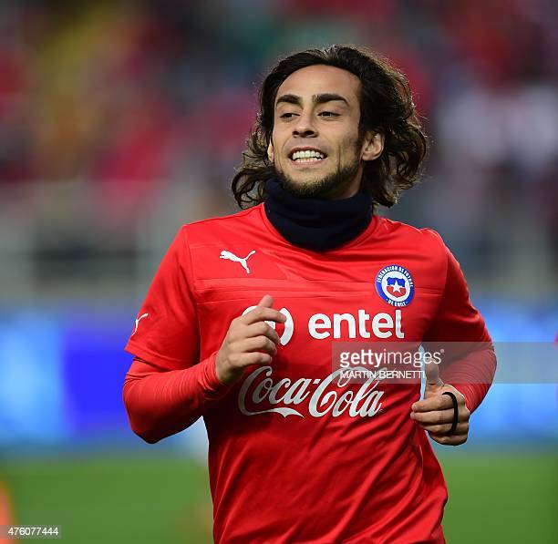 Chilean footballer Jorge Valdivia warms up before a friendly match against El Salvador at the El Teniente Stadium in Rancagua some 80 km south of...