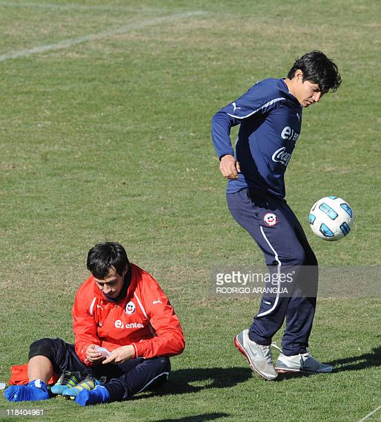 Chilean footballer Matias Fernandez controls the ball next to teammate Jorge Valdivia during a training session in Mendoza Argentina on July 7 2011...