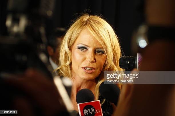 Chilean former Miss Universe Cecilia Bolocco speaks to press during her fashion show on April 8 2010 in Santiago Chile Bolocco began designing for...
