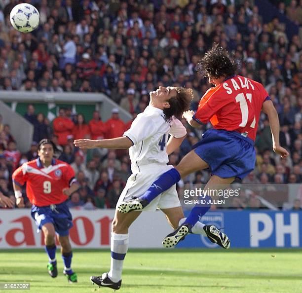 Chilean forward Marcelo Salas heads off the ball past Italian Fabio Cannavaro to score the second goal of his team as teammate Ivan Zamorano looks on...