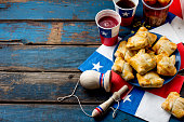 Chilean independence day concept. fiestas patrias. Chilean typical dish and drink on independence day party, 18 september. Mini empanadas, mote con huesillo, wine with toasted flour, chicha and tipica