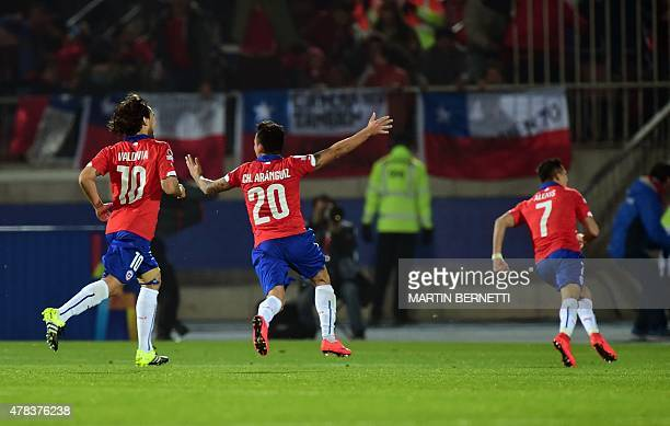 Chilean Jorge Valdivia Charles Aranguiz and Alexis Sanchez celebrate after their team scored against Uruguay during the Copa America football match...