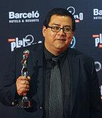 Chilean journalist Daniel Villalobos holds the award for Best Script for 'The Club' during the Platino IberoAmerican Film Awards in Punta del Este...