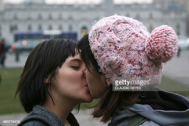 Chilean lesbians kiss in front of La Moneda presidential palace during the Week of the Lesbian Visibility in Santiago on July 10 demanding more...