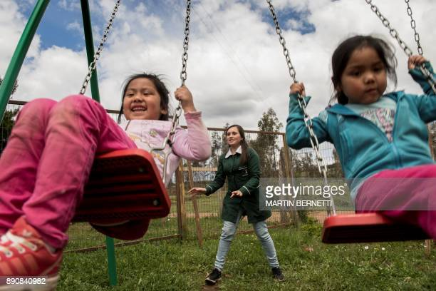 Chilean Mapuche girls rock themselves at the school in Temulemu November 09 2017 The Mapuches which represent about 7% of the Chilean population and...