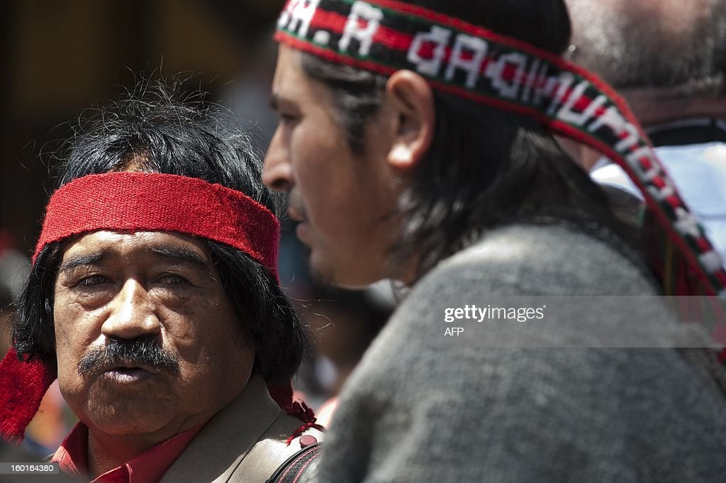 Chilean Mapuche indigenous men take part in the Peoples' Summit 'for Social Justice, International Solidarity and in Defence of the Commons', held in the sidelines of the weekend's CELAC-EU Summit, in Santiago on January 27, 2013. AFP PHOTO /Claudio SANTANA
