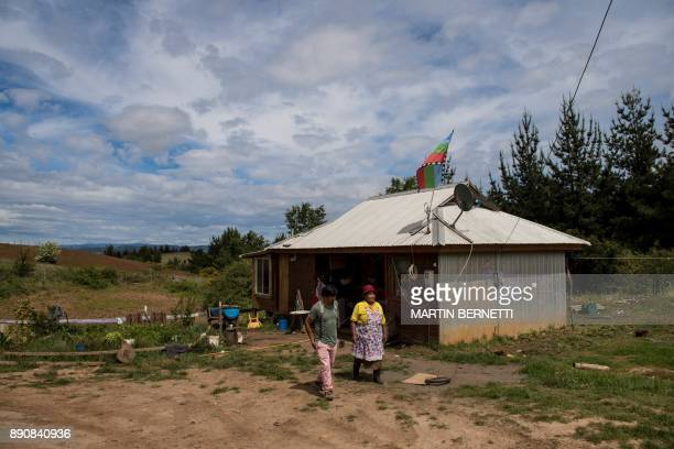 Chilean Mapuche Juan Pinchu and his mother Maria Collonao walk at their home in Temulemu on November 09 2017 The Mapuches which represent about 7% of...