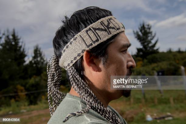 Chilean Mapuche Juan Pinchu poses outside his home in Temulemu Temuco on November 09 2017 The Mapuches which represent about 7% of the Chilean...