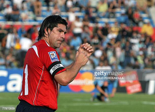 Chilean Marcelo Salas celebrates his second goal against Uruguay during their FIFA World Cup South Africa2010 qualifier football match in Montevideo...