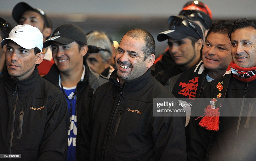 Chilean miner Mario Sepulveda reacts with fellow miners as he watches a short film about their escape during a visit to Manchester United's Old...